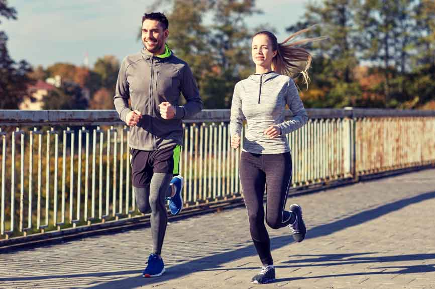 happy-couple-running-outdoors