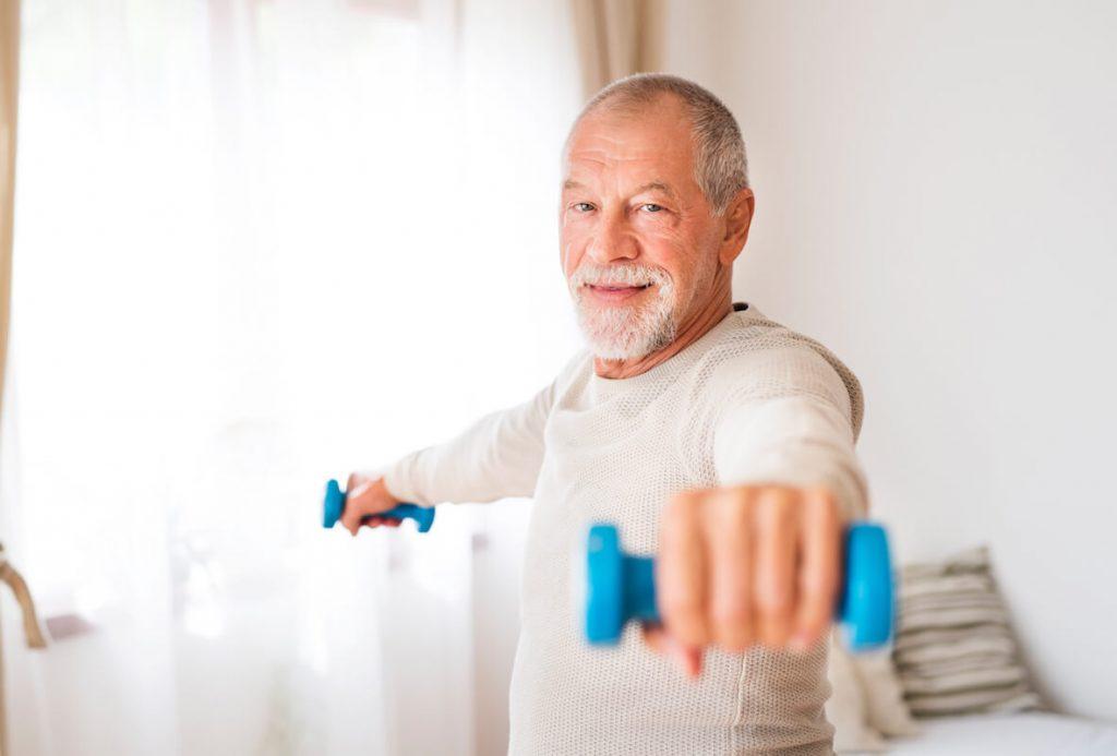 senior-man-doing-exercise-at-home